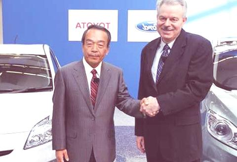 Derrick Kuzak, Ford Motor Company group vice president, Global Product Development, left, and Takeshi Uchiyamada, Toyota Motor Corporation executive vice president, Research & Development shake hands at a news conference in Dearborn, Mich., Monday, Aug. 22, 2011. The automakers announced  they will equally collaborate on the development of an advanced new hybrid System for light truck and SUV customers.  (AP Photo/Paul Sancya)